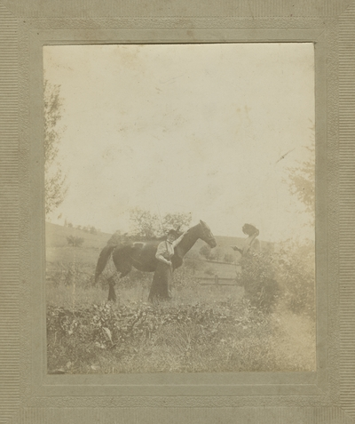 man and woman with horse