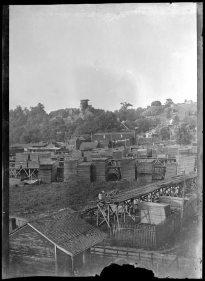 View of stacks of lumber at mill