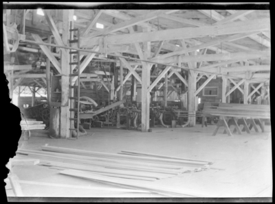 Interior of lumber mill, showing saw tables