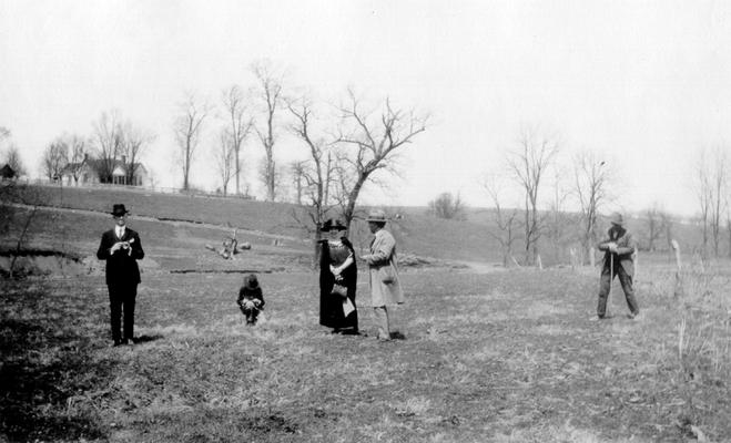 Near view of middle of 'piece of low ground remarkable for English grass,' on Grassy Lick Creek in Montgomery County, KY. People and house in view