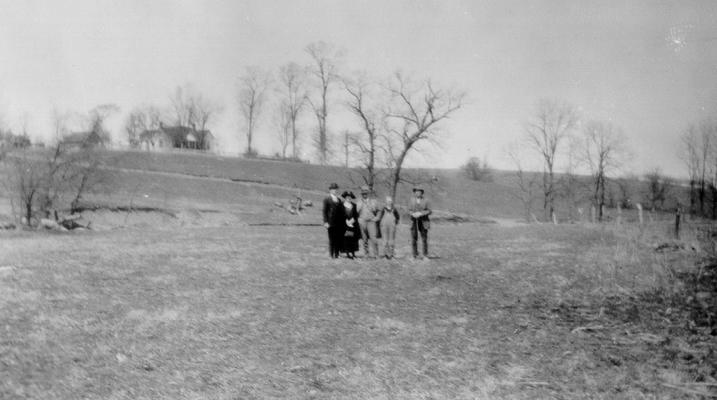 Group standing by site of abandoned saltwater wall, near middle of 'piece of low ground remarkable for English grass,' on Grassy Lick Creek in Montgomery County, KY