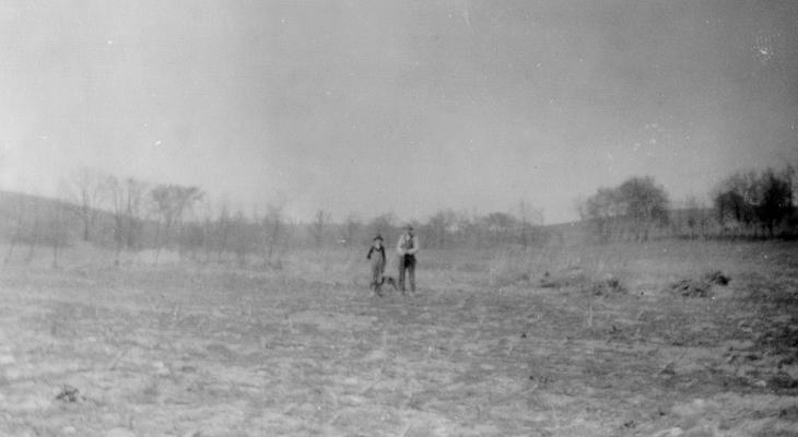 Luther B. Mason (Senior and Junior) standing at site of former salt and sulfur wall in the forks of Grassy Lick Creek. This was the orig. location of the Grassy Lick, which probably included the entire bottom in the forks