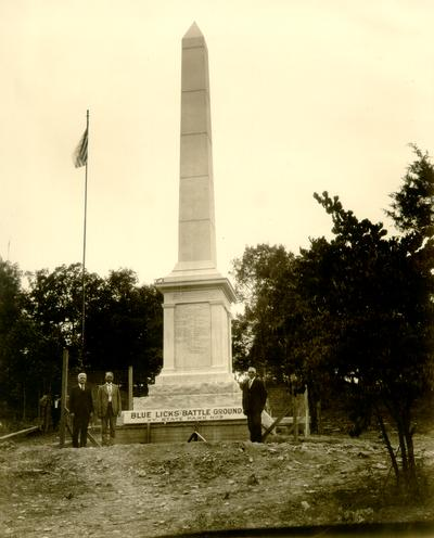 Blue Licks to Judge Wilson from W.M. Ingram. August 19, 1928. Blue Licks Battle Ground, KY. State Park No. 5; Sam Wilson and two other man in front of monument, flag in background