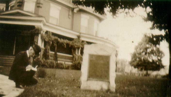 Judge Sam'l C. [?] of Johnson City, TN, copying an inscription on 'Shelby' marker at Bristol, TN