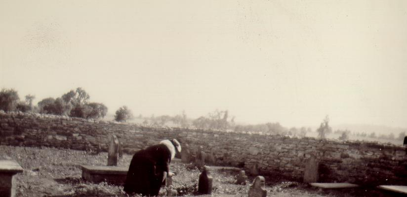 Woman in a cemetery