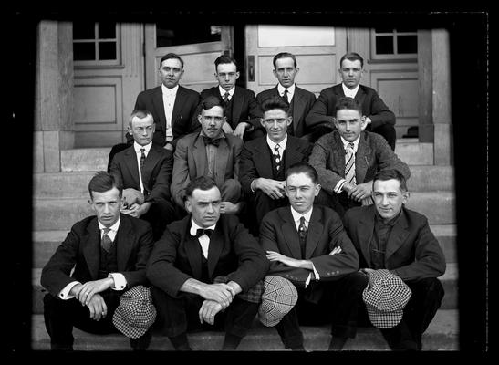 Civil Engineering class, seated without hats, caps on knees, Pence Hall steps