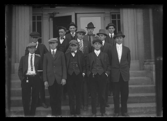 Civil Engineering class standing on steps of Civil Engineering (Pence Hall) building, all wearing caps
