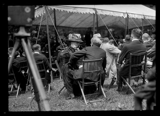 Outside tent, railroad dedication, in chairs