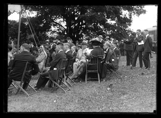 Railroad dedication, group in chairs under tree