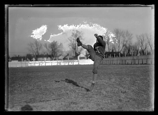 Football player kicking, William (Doc) Rodes