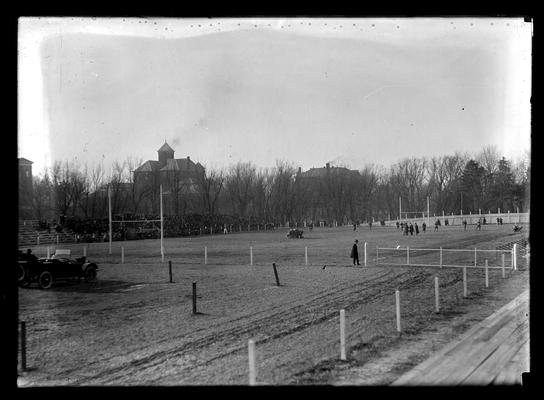 View of field, Jubilee game, from Rose Street, Barker Hall and old Education (Frazee) Building in background