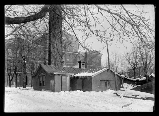 Heating plant, close-up framed by branches of tree