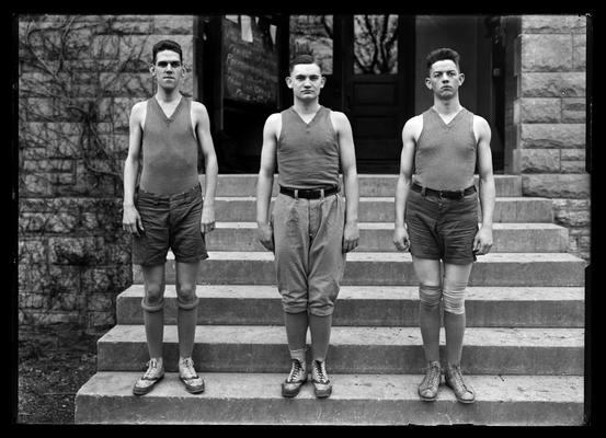 Basketball, three individuals: Bastin in middle, two others not identified
