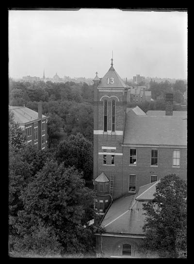 Number                          13 on tower of Barker Hall, Frazee roof to left, city in distance