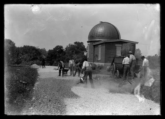 Observatory, men working on ground around building
