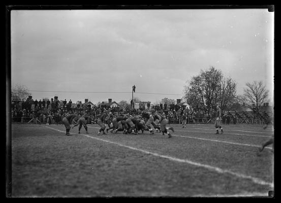Football game at Lexington, Virginia Military Institute 3-2 against University of Kentucky, player to right is upright
