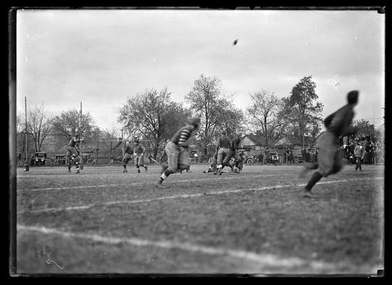 Football game at Lexington, Virginia Military Institute 3-2 against University of Kentucky, player in right foreground out of focus