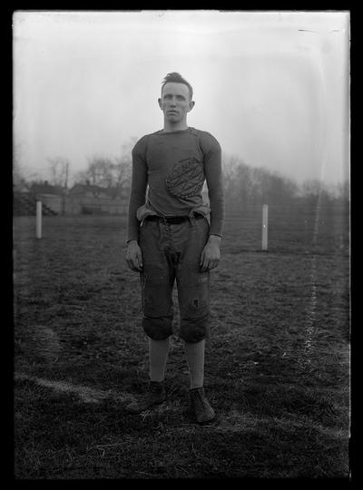 Football player on top of field, Abe Roth