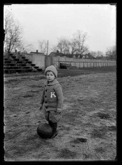 Mascot, small boy standing beside basketball, J.J. Tigert, Jr