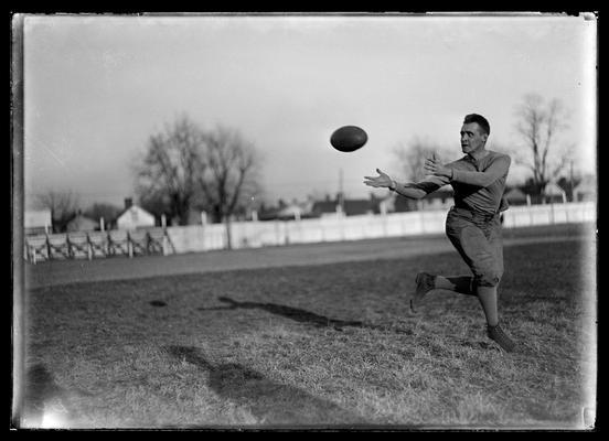 Football player receiving pass                         Morris Crutcher, captain