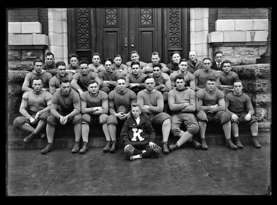 Football players in group on steps of Carnegie Library, James Park, left, back row, Captain Brittain