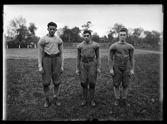 Football players in threes, unidentified