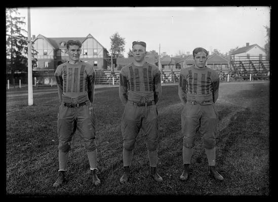 Three football players, Kenneth King, left