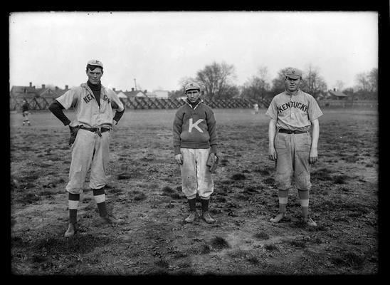 Three baseball players: South East Caudill, pitcher, Rooster Rochester, second base, Jersey Ellis, left field
