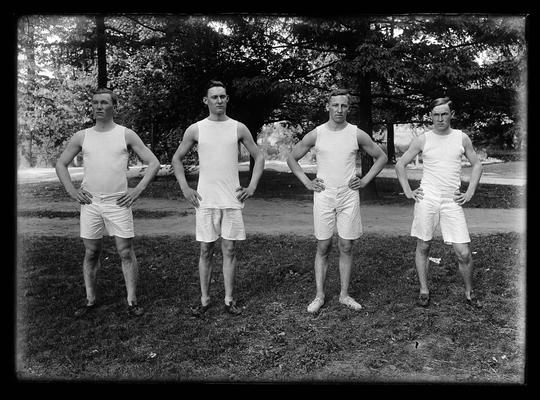 Track, four members of team, trees in background, Brick, Bull, Sallee, Davis