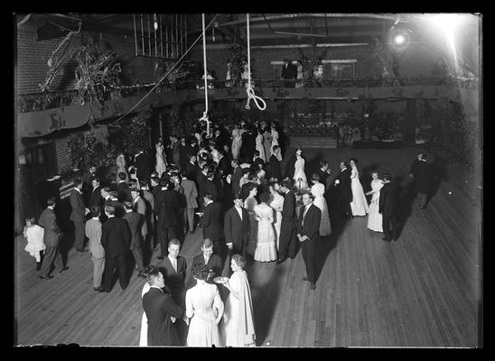 Reception in old gym in Barker Hall, few in balcony, young girl to extreme left, Halloween reception