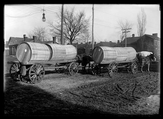 Tobacco in hogsheads, two wagons, two hogsheads each