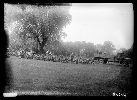 Farewell address, men seated, few women at back, horse and buggy in background