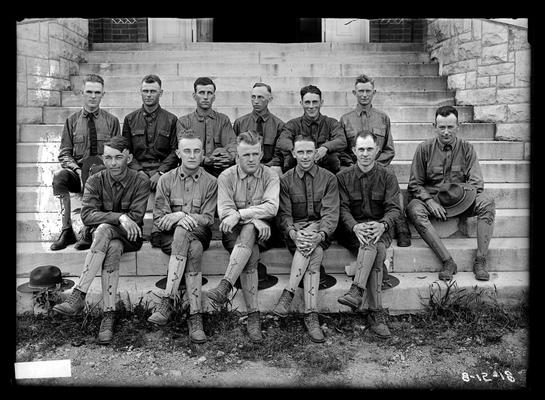 Twelve men seated on steps of Miller Hall