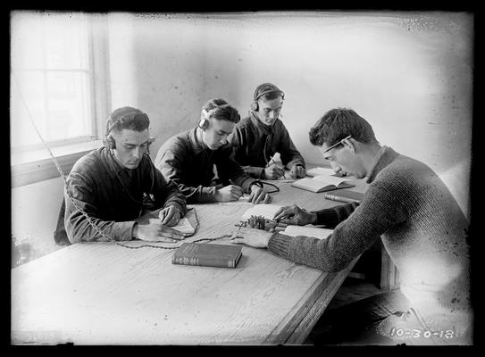 Radio class, four men at table, ear phones