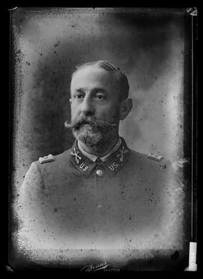 Portrait of man in uniform, beard, 3s on shoulder