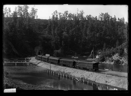Mechanical engineer's excursion to Natural Bridge train with four coaches, boats on lake, Louisville and Eastern Railroad (Chesapeake and Ohio Railway)