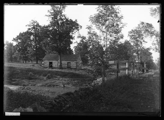 Log cabin, Fayette County, by steam of water, bridge