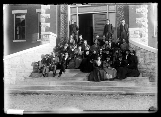 Notation Class in Botany (sophomore) Oct 1898 approcimately, co-ed, on steps of Miller Hall, three standing