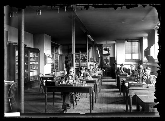 Notation                          Zoology Class Room in Station Building, Spring 1897 for catalogue, George Roberts, first to left of eight students seated at tables