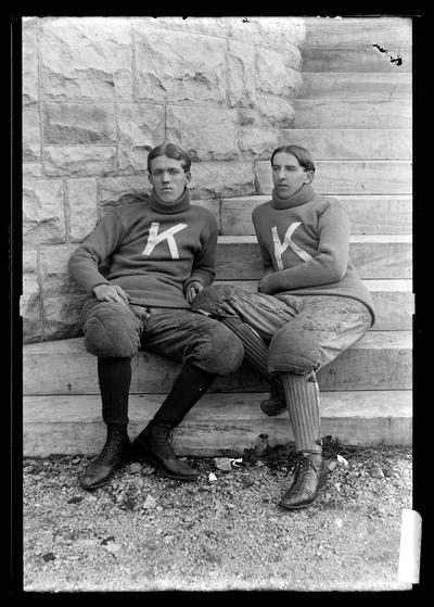 Notation Track athletes, John Willim and Elliot, about October 1898, seated on steps of Miller Hall, turtle neck sweaters, K's
