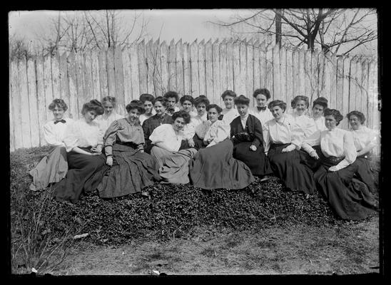 Young Women's Christian Association (YWCA), informal picture by picket fence, 1906-1907