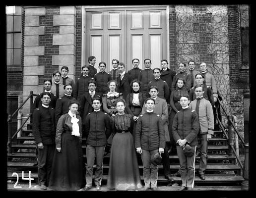 Students on steps of Administration Building (Main Building), five women, 24 men