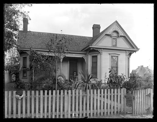 Murray House, man and dog on porch, picket fence
