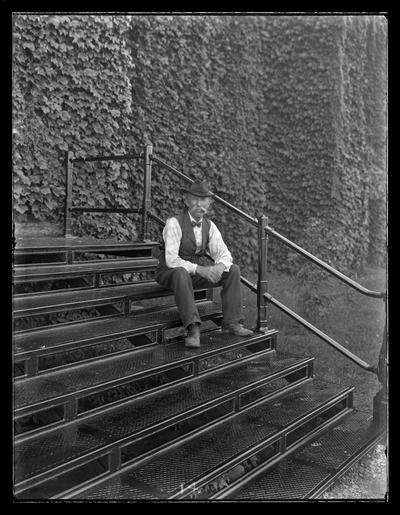 James Murray on steps of Administration Building (Main Building)