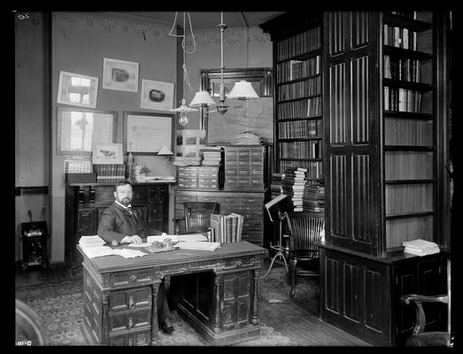 Professor M.A. Scovell, Director of Agricultural Experiment Station in his office