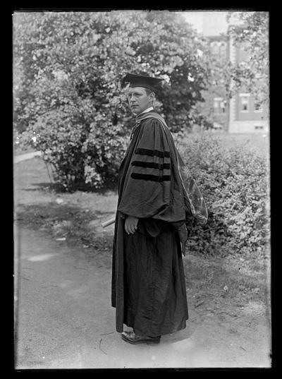R.C. Stoll in robe and hood