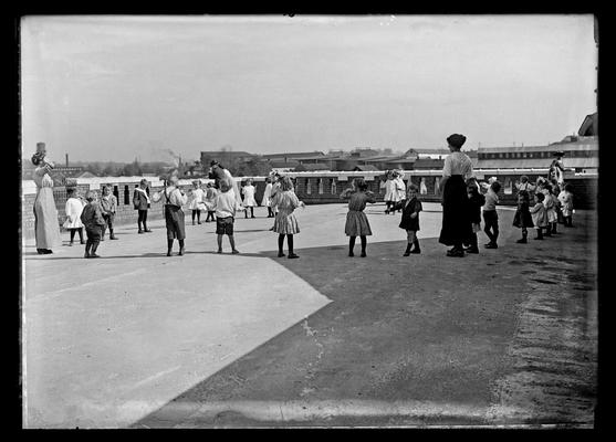 Lincoln School, health exercises on roof, two women, children, for Mrs. Breckinridge