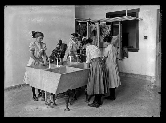 Lincoln School, girls washing in the laundry, for Mrs. Breckinridge