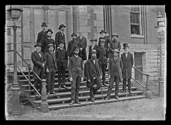 University of Kentucky faculty group, 1885, standing, hats on, on steps of Administration Building (Main Building)
