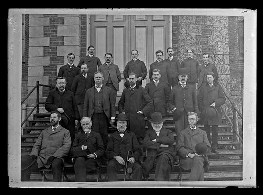 University of Kentucky faculty group seated on steps of Administration Building (Main Building), five seated, others standing